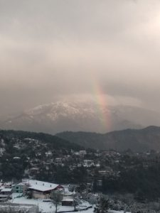 Rainbow over Dagshai Hills during snowfall