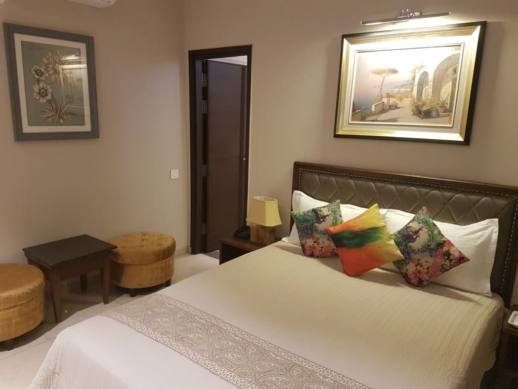 Deluxe Room has a Double bed and luxurious amenities